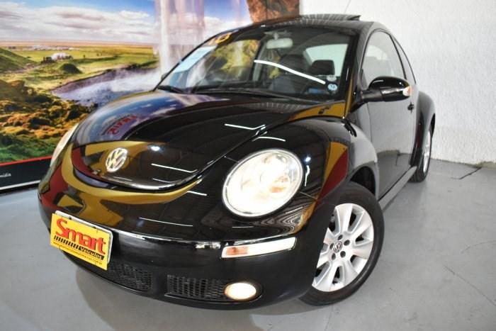 //www.autoline.com.br/carro/volkswagen/new-beetle-20-l-8v-gasolina-2p-manual/2010/sorocaba-sp/13861948