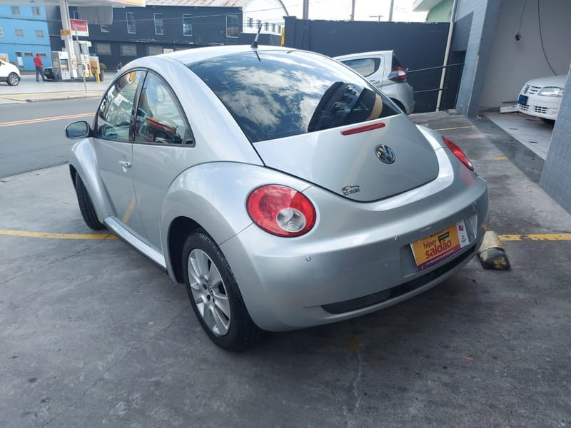 //www.autoline.com.br/carro/volkswagen/new-beetle-20-l-8v-gasolina-2p-automatico/2008/mogi-das-cruzes-sp/15027139